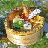 Seafood pie cooked in a glued-wood ring