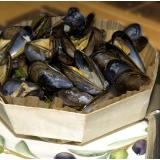 Mussels in white wine in a wooden dish