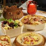 Mountain fondue and salad in wooden containers